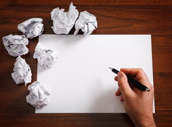 Crumpled-sheets-of-paper-trying-to-write